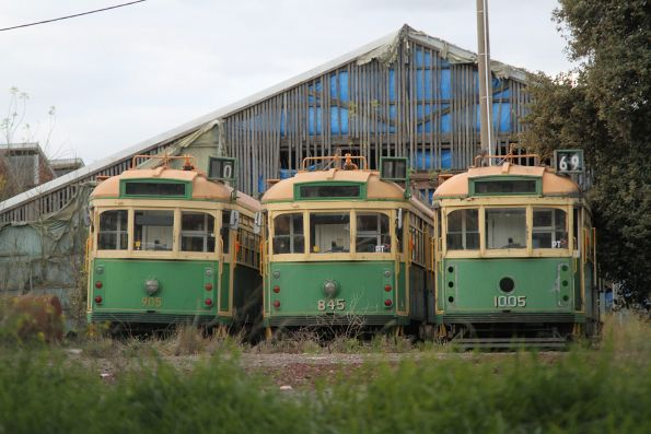 SW6.905, SW5.845 and W7.1005 stored on the ground outside at Newport Workshops