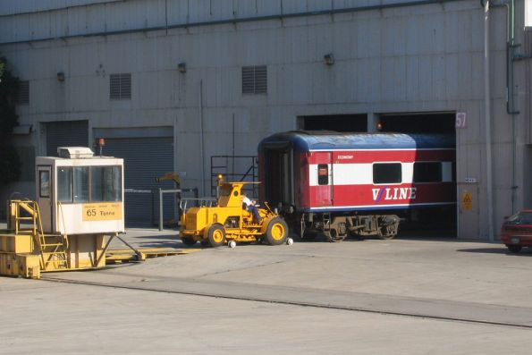 Shunting tractor pulls an BN carriage onto the traverser at Newport Workshops