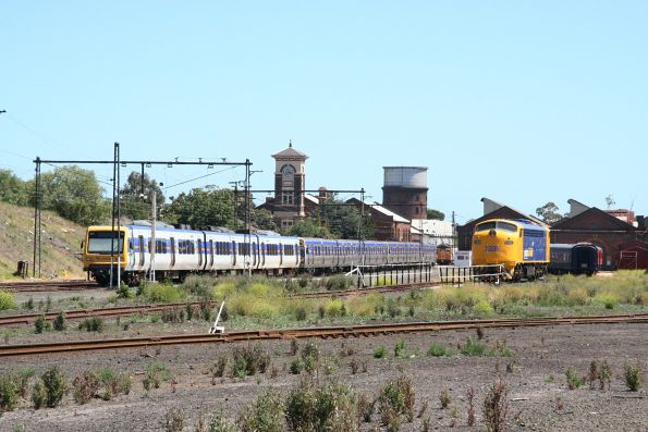 X'Trapolis and Comeng trains stabled in the Garden platform at Newport Workshops, with the Harris greaser behind, and S306 to the right