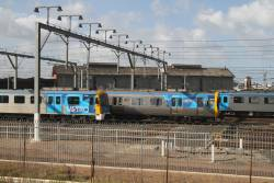 Siemens 755M and Comeng 401M stabled at Newport Workshops