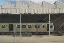 Hitachi 23M being worked on beside the Williamstown line