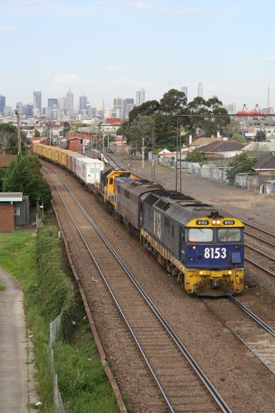 8153, GM36 and a pair of T classes depart Melbourne at Middle Footscray