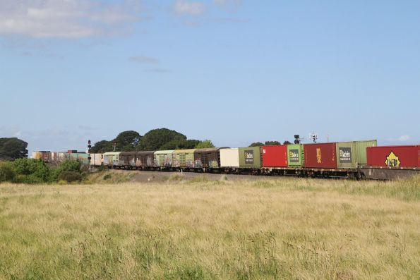 Sadleirs RLSY vans in the consist of a diverted 7SP5 freight at Sunshine