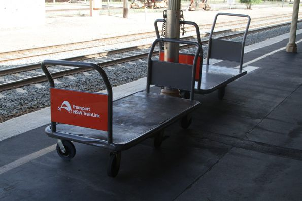 Transport NSW TrainLink branded luggage trolleys at Albury station