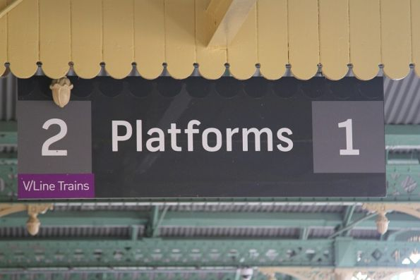 'V/Line trains' note tacked onto the platform signage at Albury