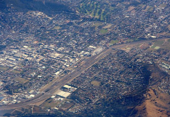 Aerial view of Albury, railway line and freeway right down the middle