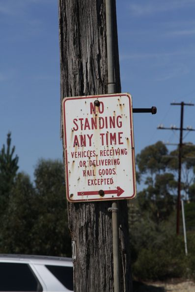 'No standing any time / Vehicles receiving or delivering rail goods excepted' sign at Kilmore East station
