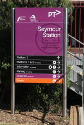 'Transport NSW TrainLink' branding on the station sign at Seymour