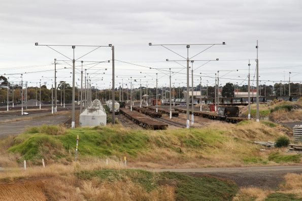 Rows of container and cement wagons stored at North Geelong Yard