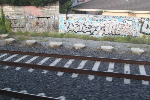 Concrete pile caps at the south end of the McKinnon station rail cutting