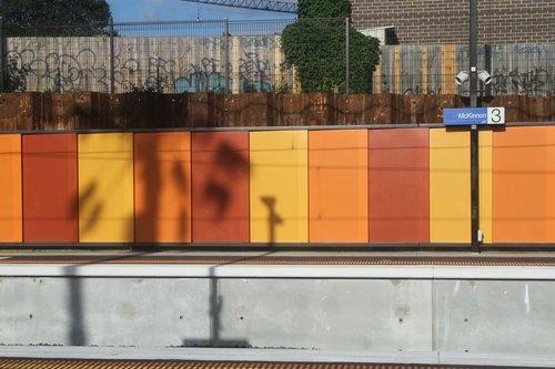 Brightly coloured platform walls at McKinnon station