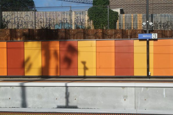 Brightly coloured platform walls at McKinnon station