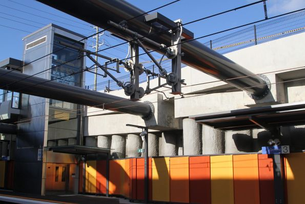 Massive steel supports keep the rail cutting at Ormond station from collapsing inwards