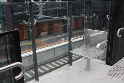 Single chair and a glasses in balustrade on the ramp up to the concourse at Ramp between platform 3 and concourse at Bentleigh station