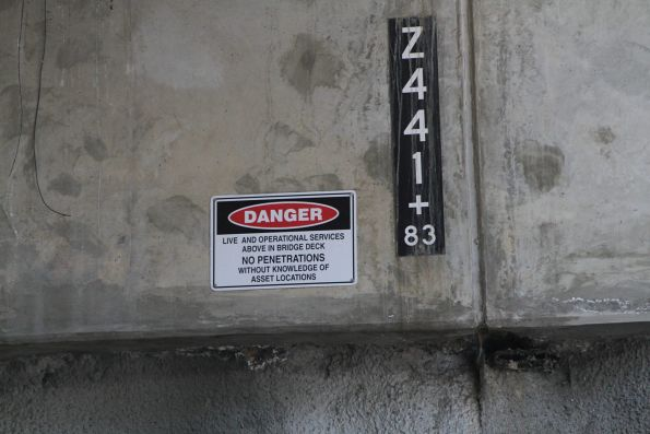 'No penetrations' warning signage beneath the road bridge deck