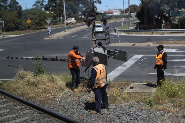V/Line crews repair a damaged boom barrier at North Shore