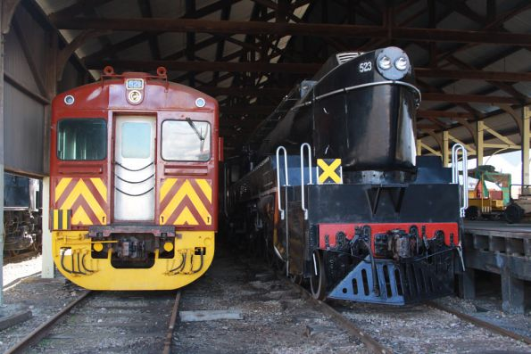 Redhen 321 sitting beside SAR steam loco 523