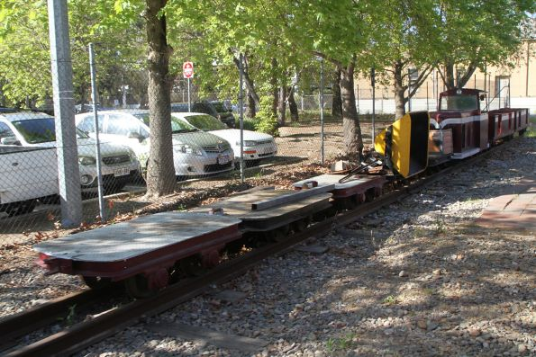 Ballast skip and flat wagons stabled on the miniature railway