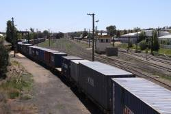 Stabled Freight Victoria container wagons in the yard at Junee