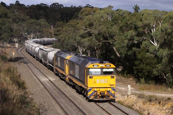 Into the sun at Bundanoon, 8182 leads 8150 on an up flour train