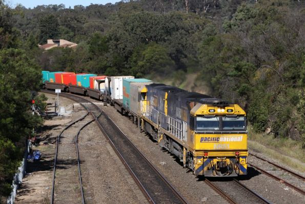 NR61 and NR39 lead a southbound container freight through Picton