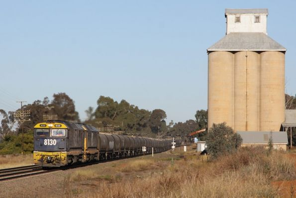 8130 and 8105 pass the disused silos at Marinna with a grain train
