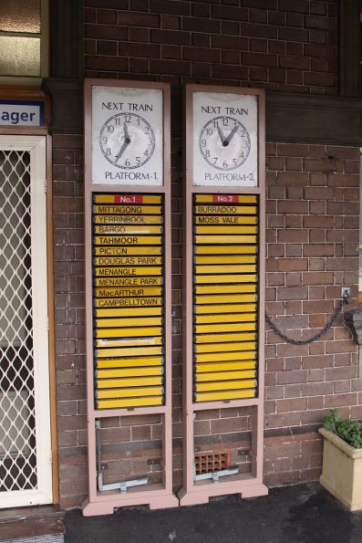 Old fashioned timber destination boards at Bowral station