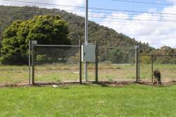Insulated fence panel beside the railway at Bowenfels