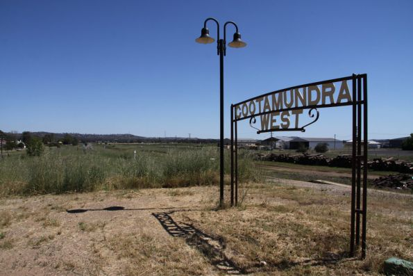 Ornate station sign and lamp at Cootamundra West