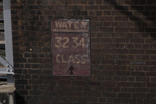 'Water: 32, 34 class' sign  under the footbridge at Cootamundra