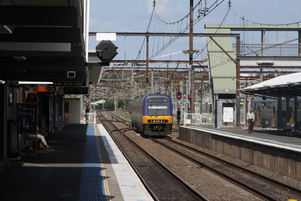 Endeavour 2803 leads an up Goulburn service into Campbelltown, bound for Central