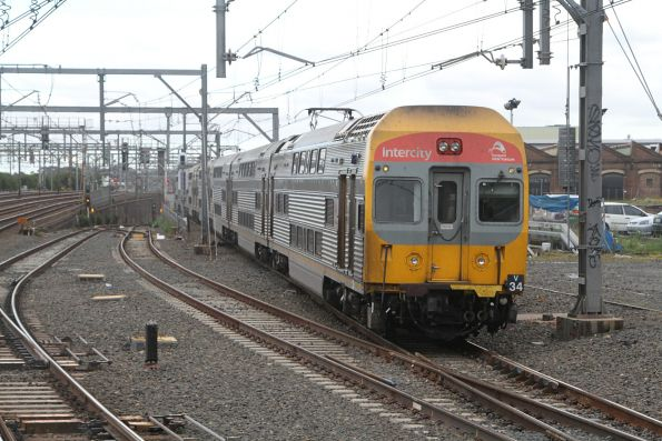 Set V34 leads a 8-car train through Redfern station on the up