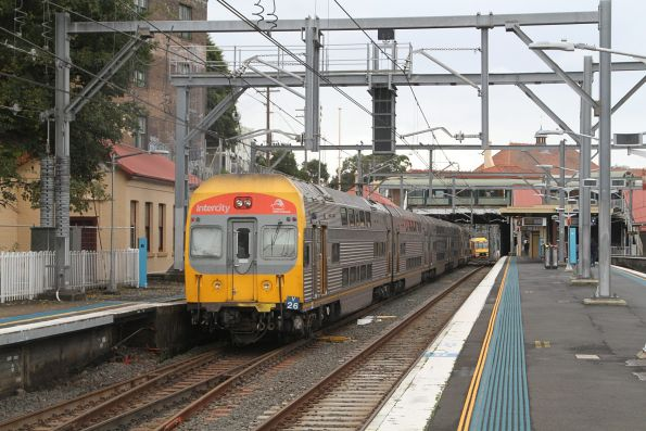 Set V26 trails a 8-car train through Redfern station on the up