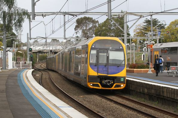 H4 leads H25 on a down Gosford service through Burwood station