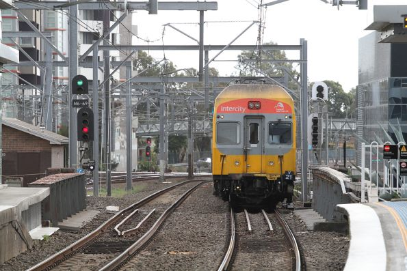 V21 leads an up service through Burwood station