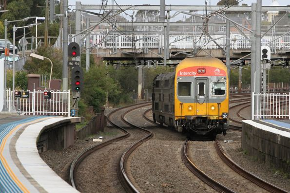 V30 leads a down service through Burwood station