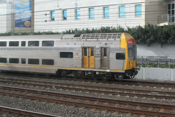 V set carriage DJM8094 leads an up service out of Strathfield