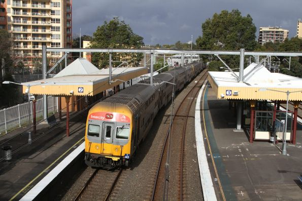 V40 trails an up service through Homebush station