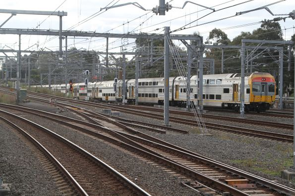 V21 leads an up train into Strathfield station