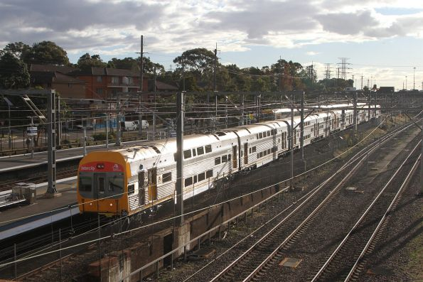 V20 passes through Flemington station with an up service