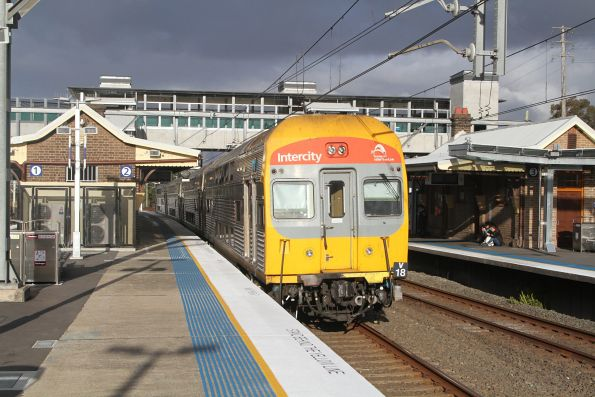 V18 trails an up service at Flemington station
