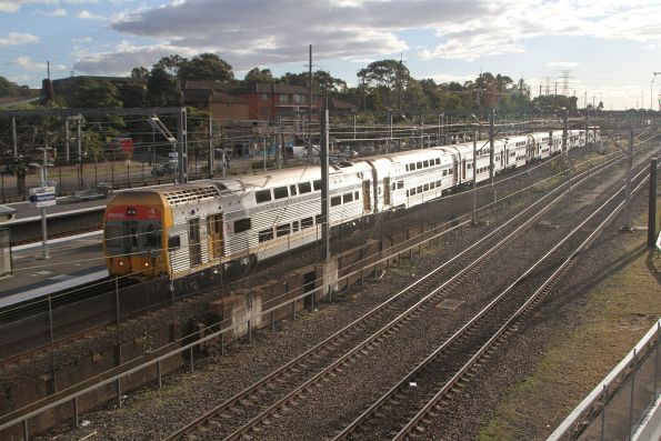 V37 passes through Flemington station with an up service