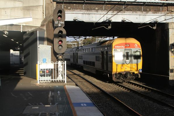 V34 leads a down train through Lidcombe