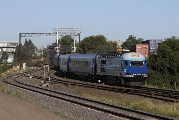 XP2008 with a repainted replacement nose leads the overnight XPT into Melbourne at Sims Street Junction