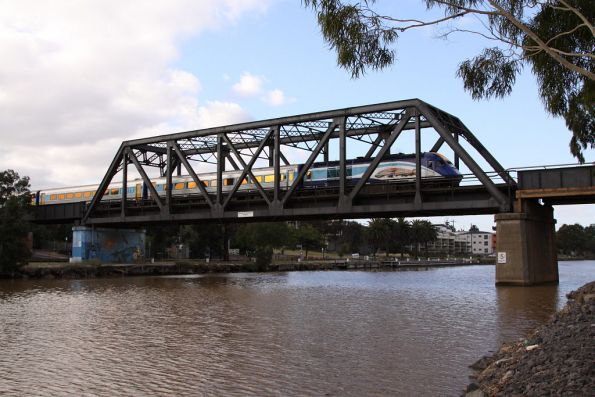 XP2001 with the 'NAIDOC Week' decal leads across the Maribyrnong River bound for Southern Cross