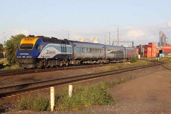 XP2001 trails the Melbourne bound XPT at Sims Street Junction
