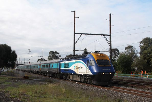 XP2010 leads the daylight XPT out of Melbourne at Sunshine