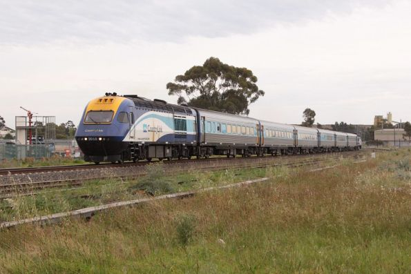 XP2010 leads the northbound day XPT towards McIntyre Loop