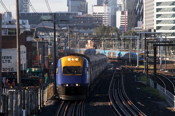 Northbound daylight XPT led by XP2014 departing Southern Cross