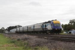 XP2002 leads a late running Melbourne-bound XPT through Albion